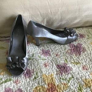 The Touch of Nina Silver Gray Satin in size 10.